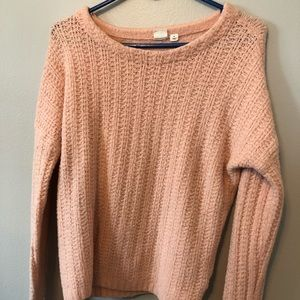 Knitted pullover light pink sweater.